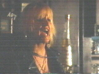 Screenshot of Bonnie as bartender in The Doors (2)