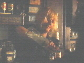 Screenshot of Bonnie as bartender in The Doors (1)