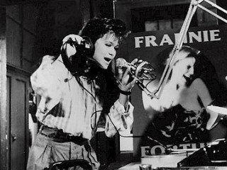 Nicole in the studio against a poster of her singing idol, Frannie Fortune